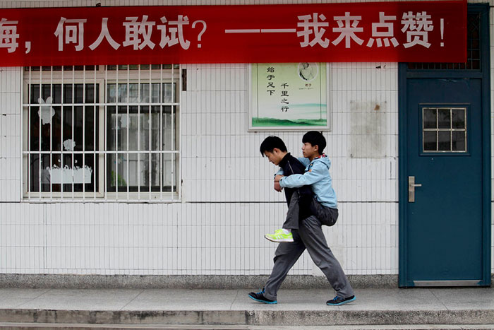 Student Carries His Disabled Classmate To School Every Day For 3 Years