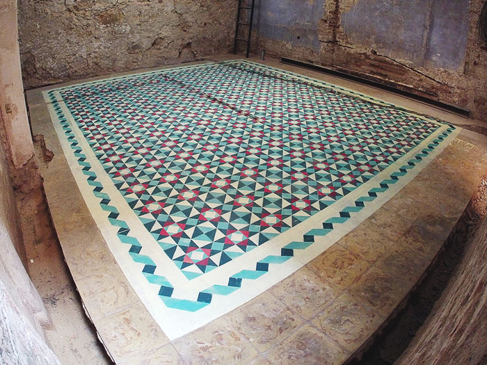 Artist Spray Paints Floors Of Abandoned Buildings With Colorful Tile Patterns