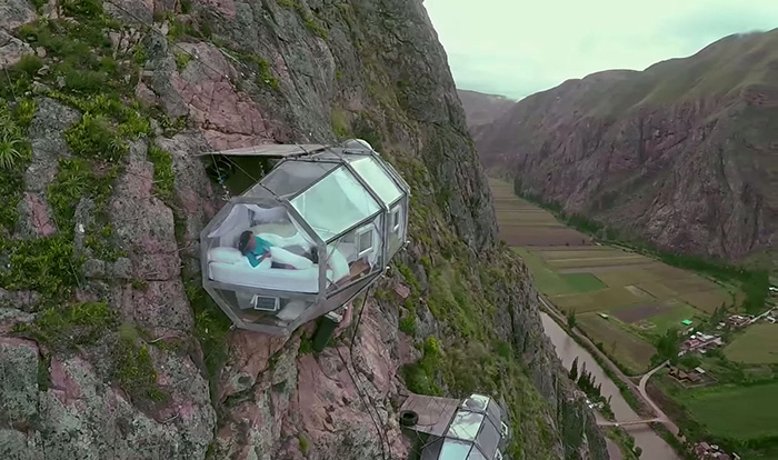 Terrifying See-Through Sleeping Capsules Hang 400 Feet Above Peru's Sacred Valley