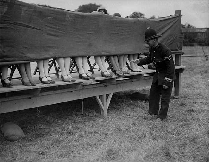 A Policeman Judges An Ankle Competition At Hounslow, London, 1930