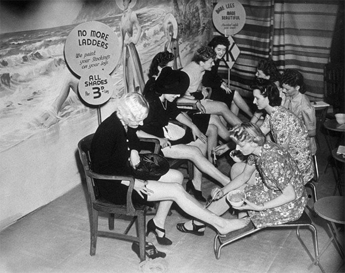 Customers Have Their Legs Painted At A Store In Croydon, London, 1941