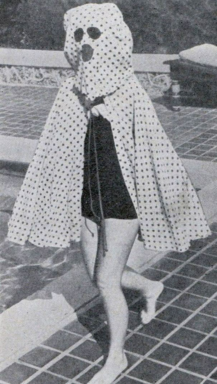 Before The Invention Of Sun-Screen In The Mid 1940s, Bathers Wore Garments Like This Freckleproof Cape To Protect Themselves From The Sun. The Cape Also Features Built-In Sunglasses