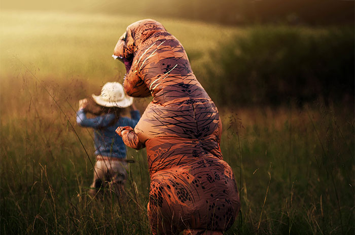 Internet Is Laughing At These Family Pics After Mom Lets Autistic Son Wear T-Rex Suit As He Hates Being Photographed
