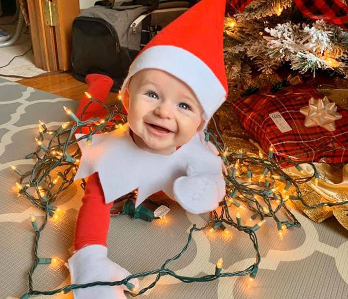 Every Advent Day This Mom Took A Photo Of Her Baby, Dressed As A Baby Elf On The Shelf