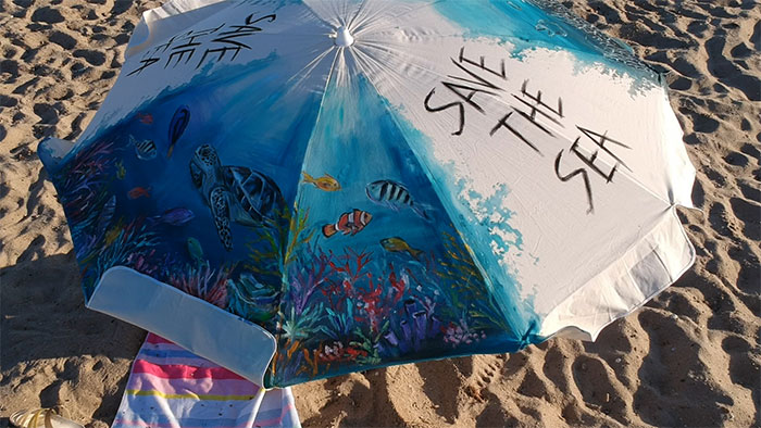 I Painted My Beach Umbrella To Show What Will Happen To Marine Life If We Don't Make A Change