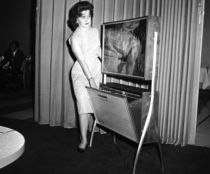 A Thin TV Screen (Only 4 Inches Thick) With An Automatic Timing Device To Record TV Programs For Later Viewing Is The Wave Of The Future As Shown At The Home Furnishings Market In Chicago, Illinois, On June 21, 1961