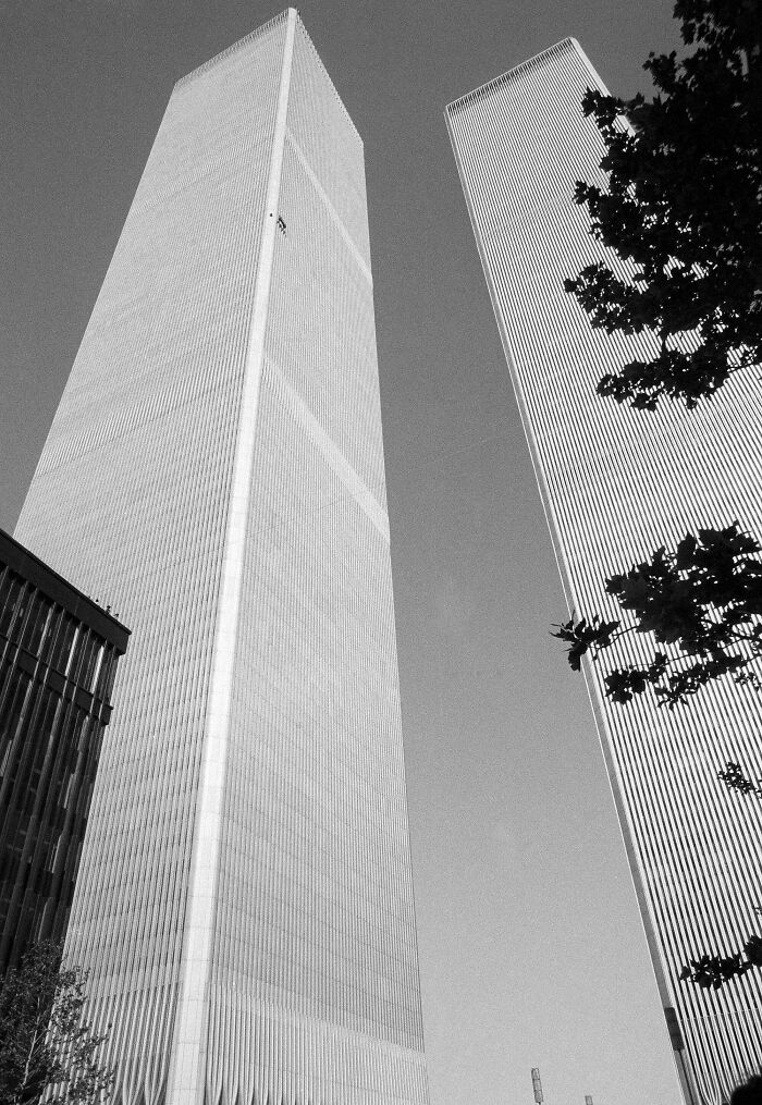 """""""Human Fly"""" George Willig Scales The Exterior Of The World Trade Center's South Tower In 1977. Completing The Climb In 3.5 Hours, He Was Arrested At The Top After Signing Several Autographs, And Was Fined $1.10 By The City - A Penny For Each Floor He Passed"""