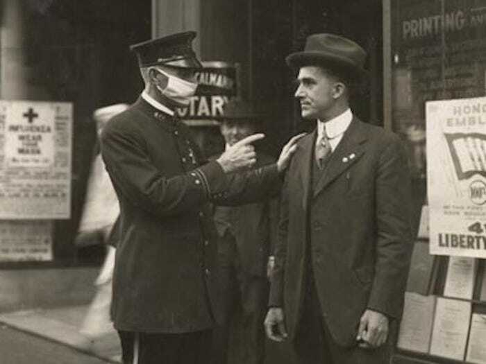 A Policeman In San Francisco Scolds A Man For Not Wearing A Mask During The 1918 Influenza Pandemic, 1918