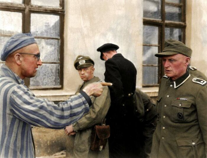 Russian Inmate Points An Identifying And Accusing Finger At A Nazi Guard Who Was Especially Cruel Towards The Prisoners In Buchenwald Camp