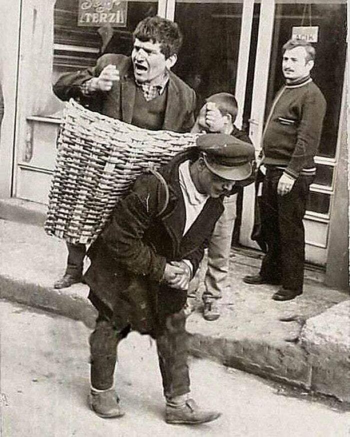 """""""The Drunk Basket."""" In The 1960s, Bars In Istanbul Would Hire Someone To Carry Drunk People Back To Their Homes"""