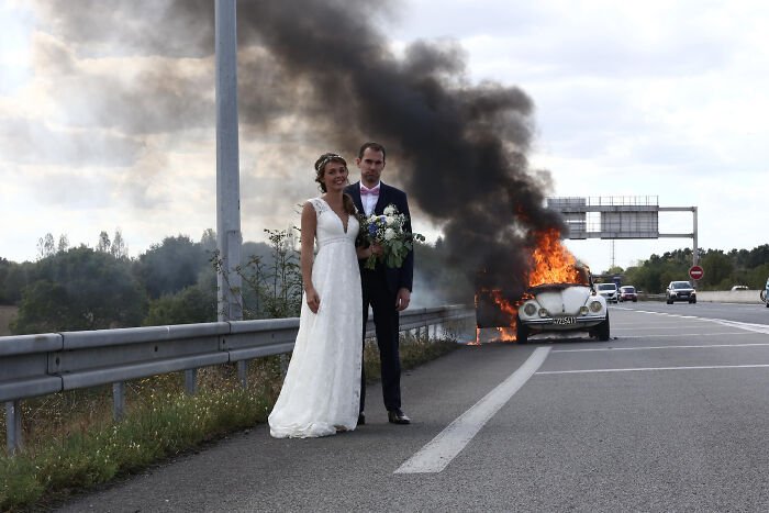 Newly Wedded In Front Of Their Burning Car