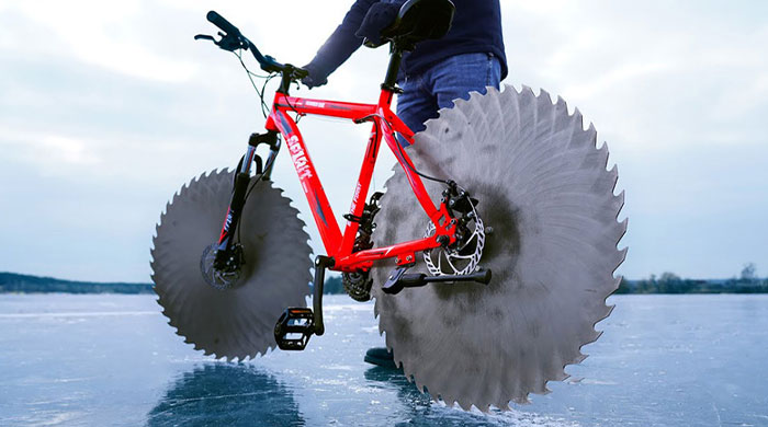 Man Replaces Bike Tires With Circular Saws And Goes For A Spin On A Frozen Lake